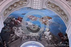 Photo made at Queen's Palace in Turin in Piedmont (Italy). Queen's Palace is located just outside the city and beyond to beautiful interiors full of paintings and frescoes has a beautiful garden. The picture shows one of the beautiful frescoes that decorate the vault of a room of the villa. The prevailing color in the fresco is the dark blue sky.