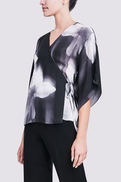 Elie Tahari- ROONEY WRAP BLOUSE: Boasting a fluid silhouette, this double georgette silk blouse bestows an elegant ease to any ensemble courtesy of kimono style sleeves and an adjustable wrap tie.