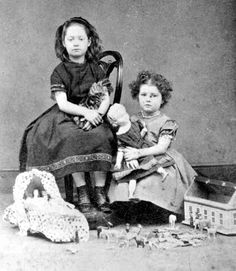 girl on chair is deceased.--well that's creepy and while this was common back then to have a photo of or with a dead family member, that must have been so hard for the poor little sister.
