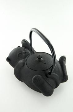 "Japanese maneki-neko (literally ""beckoning cat"") lucky cat cast iron teapot in shape of cat on its back waving a raised paw, bail handle, Japan"