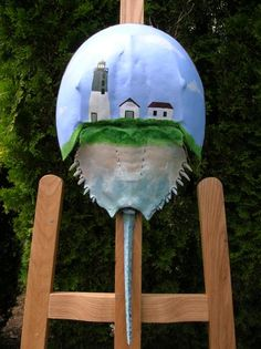 Lighthouse painting on a horseshoe crab carapace