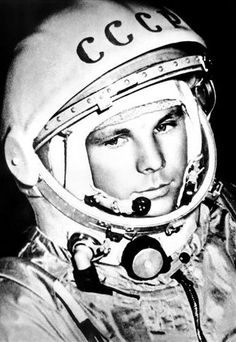 Cosmonaut Yuri Gagarin becomes the first human to enter Space and orbit the Earth, helping boost the Soviet space program and intensify the space race with the United States. Yuri, Juri Gagarin, Rock Revolution, Photos Rares, Space Race, Space Program, First Humans, Jolie Photo, Space Exploration