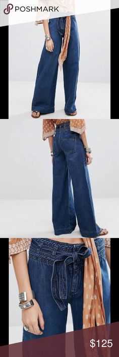 Free People Maytal Wide Leg Jeans Free People is feminine in spirit and Bohemian in attitude. From sweet to tough, tomboy to romantic, Free People mishmash color and prints across an inspired collection of free-flowing maxi dresses, super-soft jersey and leather ankle boots. These amazing jeans feature: Non-stretch denim, High-rise waist, Belt tie, Concealed fly, Functional back pockets, Wide leg, Regular fit - true to size, Machine wash, 100% Cotton Color – Maytal Blue Free People Jeans…