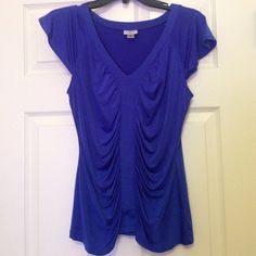 Pretty Blue Blouse This pretty blue blouse is perfect for a day or evening wear! It is quite soft when you touch it and comfortable to wear because it's made up of 95% polyester and 5% spandex. Let me know if you're interested! Worthington Tops Blouses