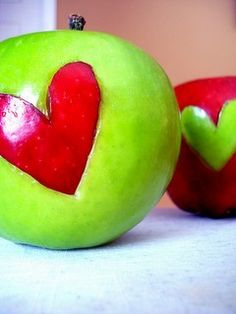 Very healthy and cute. Just cut out a piece of apple with a stainless steel heart shaped cutter and insert it in a different colored apple.