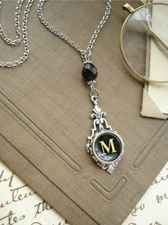 OK...as soon as I find th %*#_ keys to buy somewhere...I'm going to town on this idea!  Vintage typewriter key jewelry that you can make yourself!