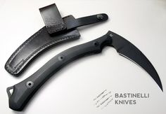 """Description Bastinelli Creations - Reaper Tac. Model: BAS201. 10 1/2"""" overall. 4 1/2"""" cutting edge. 6 1/2"""" black oxide coated Bohler N690 stainless axe head. Black smooth G10 handle. Full, extended tang. Lanyard hole. Black leather belt sheath..."""