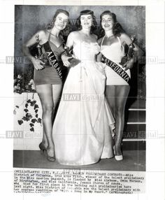 1952 press photo of Miss America 1953 bathingsuit. Text on photo includes: Win Preliminary Contests: Miss District of Columbia, Iris Anne Fitch, winner of the talent preliminary in the Miss America pageant, is flanked by Miss Alabama, Gwen Harmon, of Birmingham, and Miss California, Jeanne Shores of Azusa, who tied for first place in the bathing suit preliminaries here last night. Photo is dated: 9-4-1952