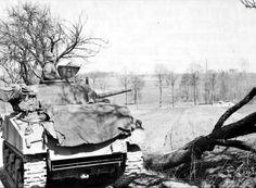 An M4A3 Sherman of the 761th tank battalion covers the actions of the 103rd Infantry Division in France.