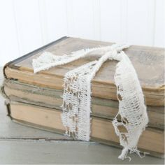 I love old books tied with ribbon.