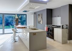 A kitchen designed by bulthaup Winchester. High gloss, aga and Zebrano bartop!