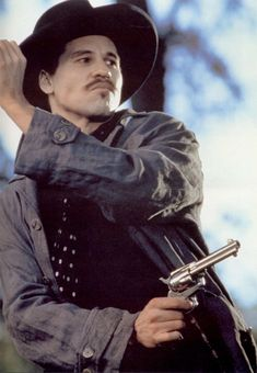 Val Kilmer as Doc Holliday!  This is one of the best scenes in the film..he is deciced he might need to finally drop a cigarette while he did THIS job. Tossing his cig while taking out the bad guy. It was awesome.