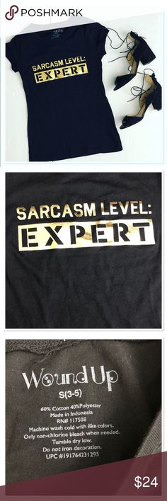 """Printed graphic short sleeve tee sarcasm expert Printed graphic short sleeve tee sarcasm level expert. Perfect cap sleeve tee with golden printed graphic. Stretchy soft and comfortable. So cute and trendy for spring and summer.  Size S.  Pit to pit: 16""""  Length: 24""""  60% cotton 40% polyester. Tops Tees - Short Sleeve"""