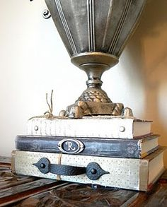 repurpose old books with a little flare.  love the colors and the monogram letter.