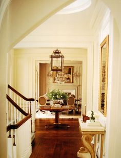 foyer with lantern, round table, mirrors