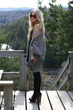 huge cardigan over LBD + clutch