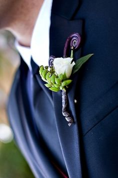White Rose and Monkey Tail Boutonniere. Monkey tail?