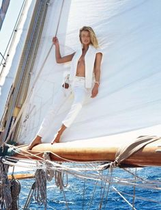 This makes me want to bask in the sun wearing stripes   denim- now if only I had a sail boat! -- Vogue Paris Model: Edita Vilkeviciute Photographer: Gilles Bensimon Styled by: Geraldine Saglio -- Levi via @WhoWhatWear