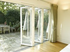 bi-fold glass door....put on the back wall opens up the space to patio. makes the cottage feel larger.