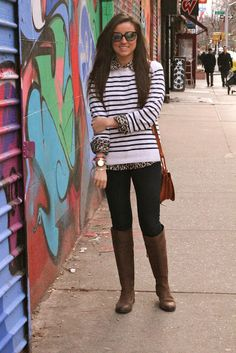 Riding boots with striped shirt and jeans.