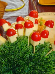 Woodland birthday party food - mushroom made from mozzarella cheese and tomatoes