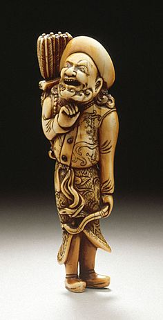 Japan  European Archer, 18th century  Netsuke, Ivory with staining, sumi, inlays