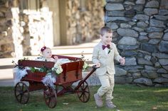 Ringbearer carrying flower girl in floral cart - love this!  - Beautiful Burgundy and Tan Wedding - Molinski Photo