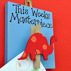 dinosaur art work holder -- use those little wooden shapes from craft store