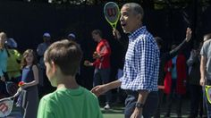 President Barack Obama reacts while playing tennis during the White House Easter Egg Roll at the White House in Washington, Monday, March 28, 2016. Thousands of children gathered at the White House for the annual Easter Egg Roll. This year's event features live music, sports courts, cooking stations, storytelling, and Easter egg rolling. (AP Photo/Jacquelyn Martin)