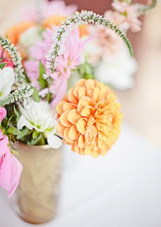 Orange and pink floral centerpiece | photos by Meg Perotti | Planning Sitting in a Tree |100 Layer Cake
