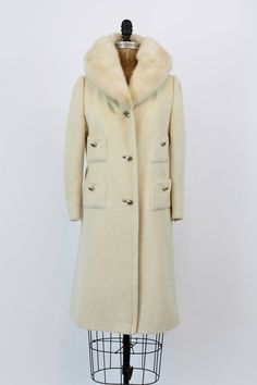 Perfectly chic 1960s Lilli Ann Petite coat! Done in an ivory wool with thick winter white mink collar. Buttons down front and on the patch pockets.