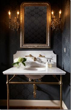 Love this bathroom with gold,brass, black and white.  So mysterious.