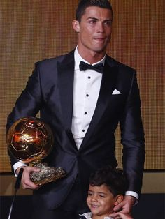 Cristiano Ronaldo: Portugal's famous footballer, Ronaldo shares his joy of winning the FIFA Ballon d'Or 2013, and being named the world's best footballer for the second time, with son Christiano Ronaldo Jr. Both father and son look overjoyed, basking in the glory of victory.