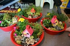 love these fairy gardens.  my boys would love making these, although they would be safe havens for super heroes or endangered animals.