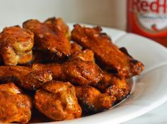 Classic Buffalo wings are fried but I love the flavor and ease of cooking them on the grill. They are truly no fuss, no muss and finger lickin' good! The key is to cook them over a moderate flame so that the fat renders out and the skin gets nice and crispy. The seasoned Buffalo sauce gives the wings a little kick but is still mild enough for most