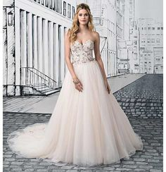 Glamorous brides everywhere can sit back and relax, because I've found your perfect wedding dress. Style 8889 has the most intricate embellishment on its bodice, and the choice of warm colours really works well. The sweetheart neckline is girly and gorgeous in every way and works perfectly with the full tulle skirt.