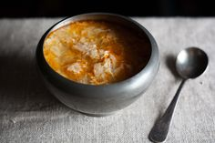 Sopa de Ajo - Garlic Soup. 'After a brief simmer, your pot will be full of wisps of bread, swimming in a broth tinted red from paprika and swirled, lava lamp-style, with olive oil..
