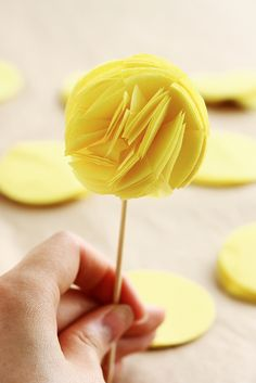 mini pom cupcake toppers - would also make an adorable garland