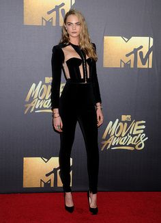 Model Cara Delevingne arrives at the 2016 MTV Movie Awards at Warner Bros Studios on April 9 2016 in Burbank California