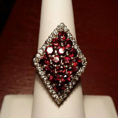Check out this item in my Etsy shop https://www.etsy.com/listing/211808403/genuine-garnet-sterling-ring-size-7