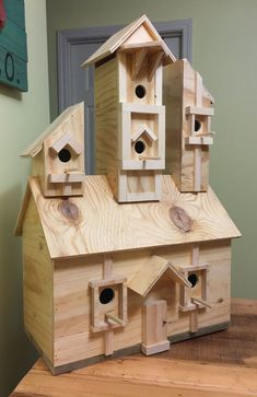 Large Birdhouse Manor with 6 Spacious Living areas. Commissioned work for Hoosier Coffee Co. of Indiana. Unpainted at Clients Request.