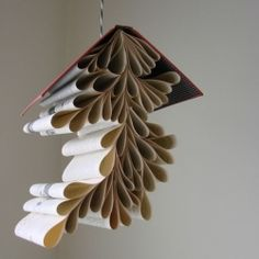 I love interesting creative ideas with everyday objects!  I love my books, but I think I would part with one to make this.