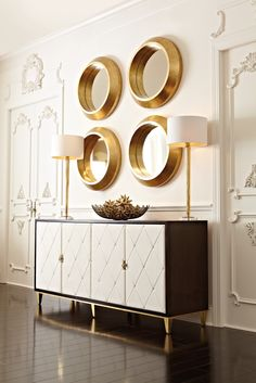 Glam #gold mirrors as stunning wall #decor over a beautiful quilted sideboard #cabinet by @Bernhardt Furniture