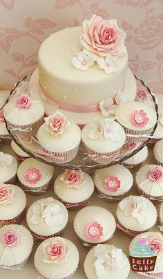 Pink Wedding Cakes - An Ivory and Dusky Pink Cupcake Tower. Top cutting cake decorated with icing pearls, a large sugar rose and sugar hydrangea petals. The cupcakes are decorated with sugar roses, glittered roses, blossom flower and hydrangea petals. Pink Wedding Cupcakes, Cupcake Tower Wedding, Pastel Cupcakes, Cupcake Towers, Flower Cupcakes, Valentine Cupcakes, Birthday Cupcakes, Fancy Cakes, Mini Cakes