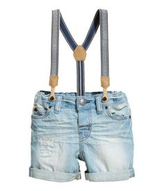 Light denim blue. 5-pocket shorts in soft, washed denim with heavily distressed details. Adjustable elasticized waistband, fly with button, and sewn cuffs
