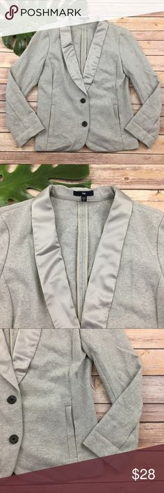 Gap light gray satin trim 2 button blazer Gap women's light gray blazer, size M. It is free from any rips or stains. It measures about 41 inches around the bust and is about 23 inches long. GAP Jackets & Coats Blazers