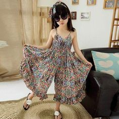 European Style Children & Young Adults Bohemian Sundress Girls Summer Floral Cool Wide Leg Pants Kids Jumpsuit 2 Colors Years Another beautiful beach jumpsuit products Material: Cotton Color: blue/o Frocks For Girls, Kids Frocks, Kids Outfits Girls, Little Girl Dresses, Girl Outfits, Dress Girl, Boho Dress, Bohemian Dresses, Summer Outfits