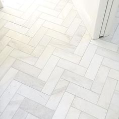 Satin white bathroom floor tile in a herringbone design - Royal Satin White Marble Subway Tile - 4 x 12 in.
