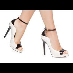 President's Day Sale NIB Colorblock Heels This edgy patent like heel features a comfort pad so you can wear it all day with ease. This off-white and black heel fits true to size with an adjustable buckle and 5.25 inch heel. Shoes Heels