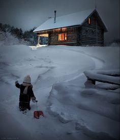 Elena Shumilova's magical, wintry photography: Boy trekking through snow to cabin